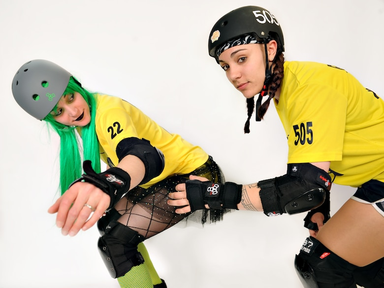 McPain and Risky Bizness, both members of the KimChicks roller derby team, pose for a photo at Osan Air Base, Republic of Korea, March 18, 2014. McPain, also known as Master Sgt. Jessica McWain, is the first sergeant for the 51st Comptrollers Squadron and Wing Staff Agencies, and Risky, also known as Senior Airman Lindsey Rath, is an operations intelligence analyst for the 36th Fighter Squadron. (U.S. Air Force photo/Senior Airman Siuta B. Ika)