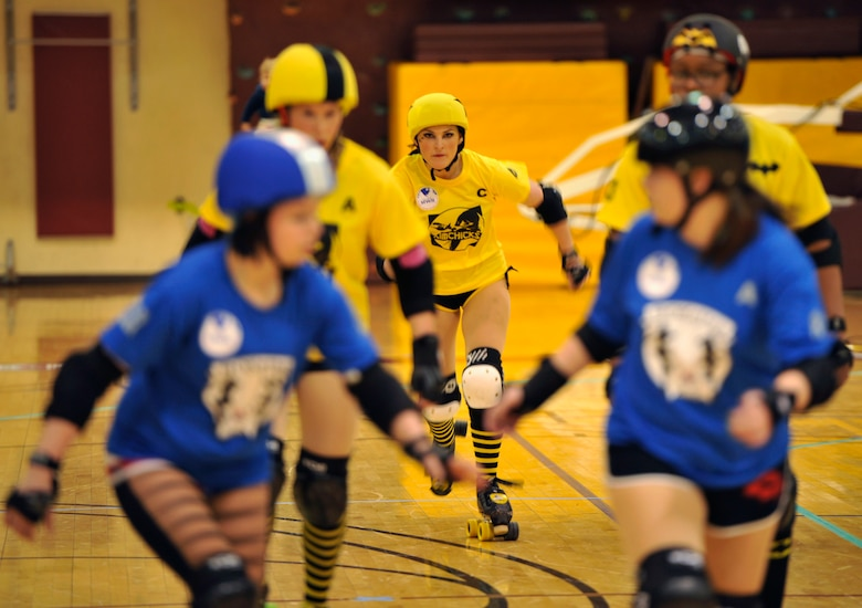 Mobsta, a member of the KimChicks roller derby team, starts a jam during a bout with the Rokettes at U.S. Army Garrison Humphreys, Republic of Korea, March 8, 2014. Both the KimChicks and Rokettes are primarily made up of active duty military members and spouses from Osan and Humphreys, who compete during monthly bouts. (U.S. Air Force photo/Senior Airman Siuta B. Ika)
