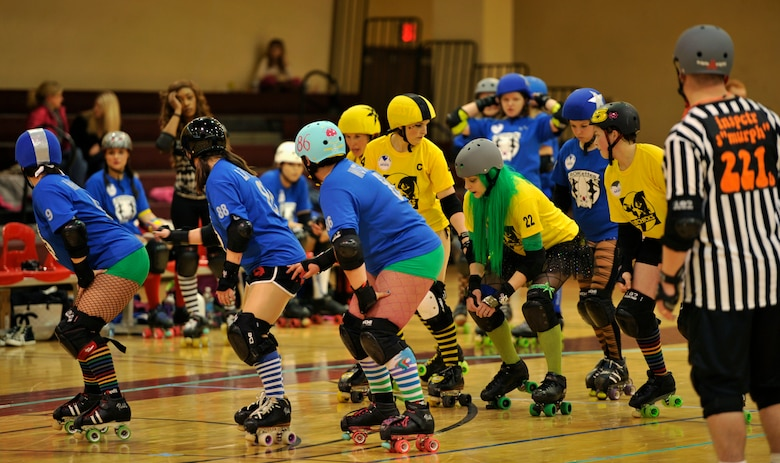 Members of the Rokettes and KimChicks roller derby teams prepare for the start of a jam at U.S. Army Garrison Humphreys, Republic of Korea, March 8, 2014. Both teams are primarily made up of active duty military members and spouses from Osan and Humphreys, who compete during monthly bouts. (U.S. Air Force photo/Senior Airman Siuta B. Ika)