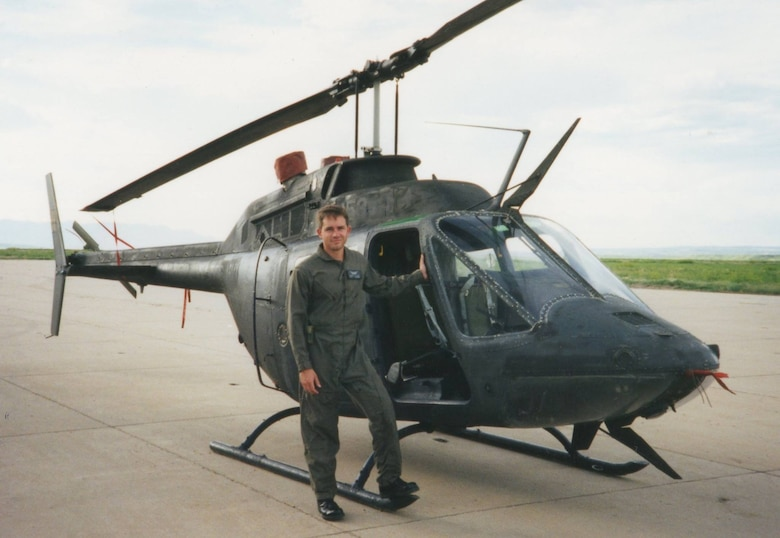Chief Warrant Officer 1 Steven Lott stands by an OH-58 scout helicopter. Lott went to flight school from 1992 to 1993. In 1995, Lott transitioned to fixed wing aircraft. (Courtesy photo)
