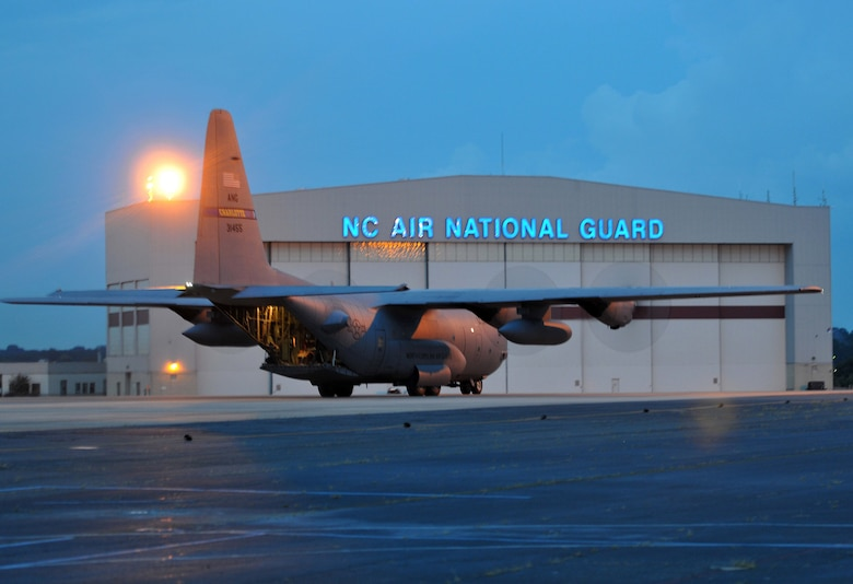 Aircrew from 156th Airlift Squadron, return home to the North Carolina Air National Guard base, Charlotte Douglas Intl airport after completing a training mission, August 8, 2013.  145th Airlift Wing's C-130 Hercules aircraft are maintained and ready to respond and support state and national missions at a moment's notice. (U.S. Air National Guard photo by Master Sgt. Patricia Moran, 145th Public Affairs/Released)