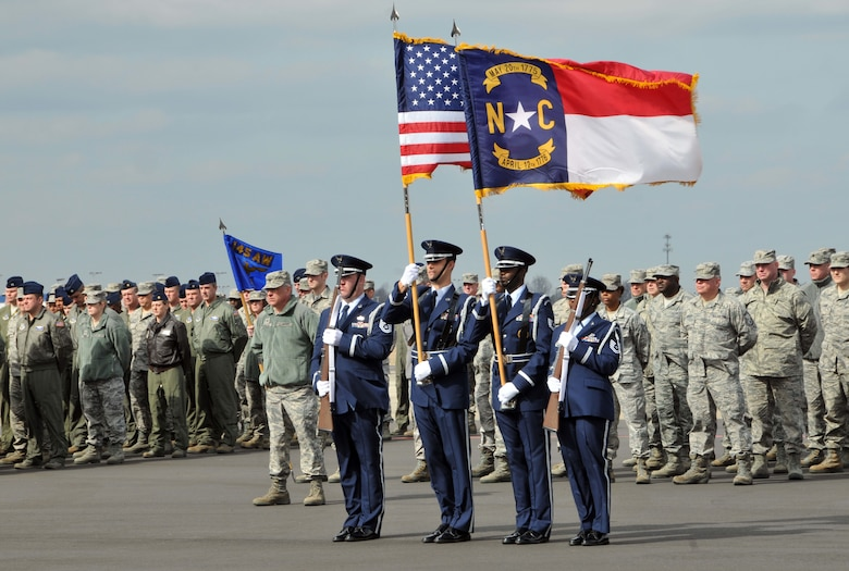 With polish and precision members of the 145th Airlift Wing's Honor Guard conduct a traditional task of escorting the national and state flag and posting the colors in front of airmen standing in formation at the quarterly commander's call held at the North Carolina Air National Guard base, Charlotte Douglas Intl airport, February 9, 2014. (U.S. Air National Guard photo by Senior Airman Laura Montgomery, 145th Public Affairs/Released)