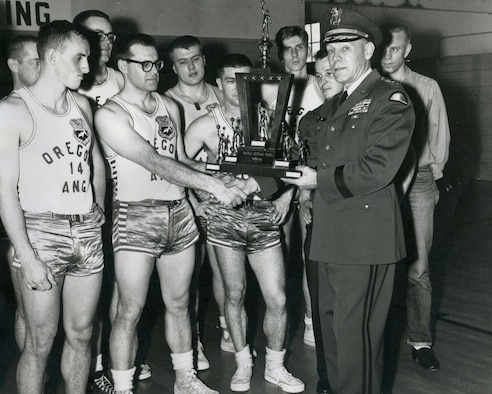 Maj.Gen. Alfred A. Hintz, The Adjutant General, presents the State Championship Trophy to the Oregon Air National Guard Champions in early 1961. (photo from the 142nd Fighter Wing History Department)