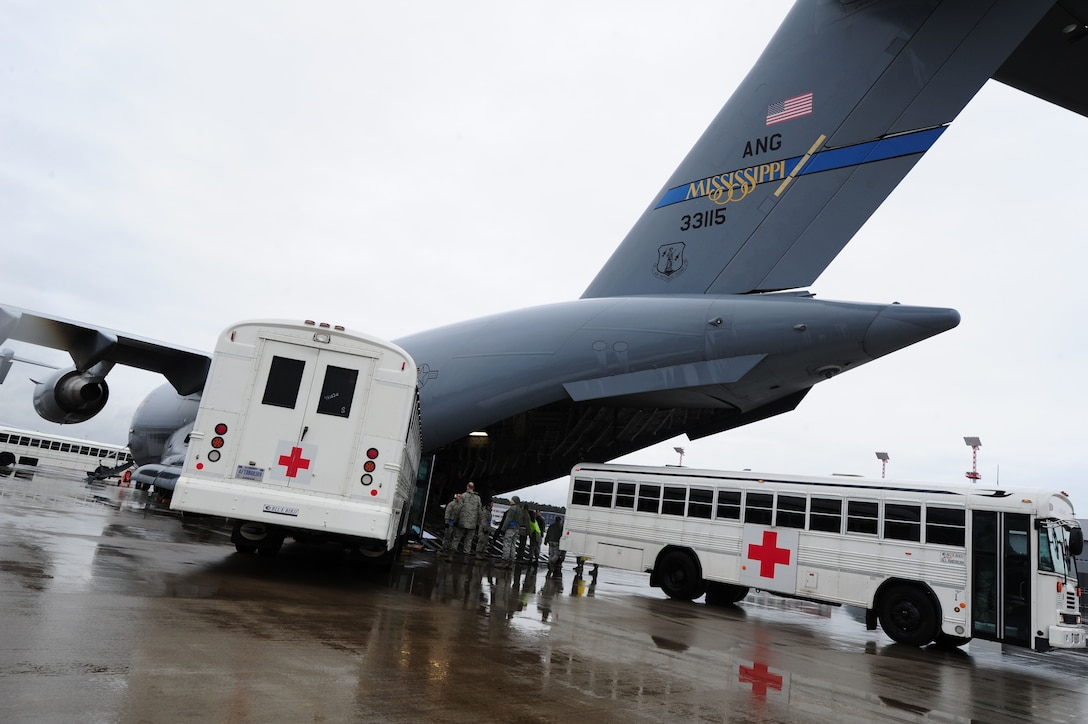 Personnel from the 86th Contingency Aeromedical Staging Facility load patients on a C-17 Globemaster III at Ramstein Air Base, Germany, Dec. 19, 2013. The CASF's primary role in the aeromedical evacuation mission is to evaluate patients' medical records, stage patients and secure appropriate transportation for higher-level care. (U.S. Air Force photo/Airman 1st Class Aaron Stout)