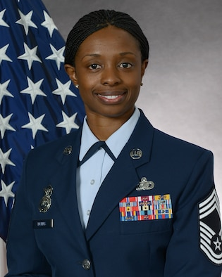 """Chief Master Sgt. Tamar Dennis, 51st Security Forces Squadron manager, represents one of Osan Air Base's inspiring women. March is Women's History Month with the theme """"Celebrating Women of Character, Courage and Commitment."""" (Courtesy photo)"""