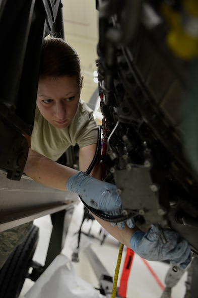 U.S. Air Force Airman 1st Class Jessie Rumbaugh, 52nd Component Maintenance Squadron aerospace propulsion apprentice from Terreton, Idaho, removes a T4B pyrometer off of an F-16 Fighting falcon fighter aircraft engine from Aviano Air Base, Italy, March 18, 2014, at Spangdahlem Air Base Germany. A pyrometer is an instrument to measure the temperature of internal engine components. (U.S. Air Force photo by Staff Sgt. Christopher Ruano/Released)