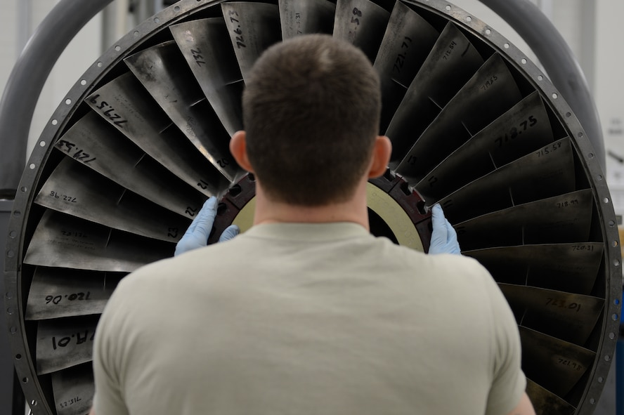U.S. Air Force Senior Airman Kyle Watson, 52nd Component Maintenance Squadron aerospace propulsion journeyman from Sanford, N.C., installs stage-one fan blades on an F-16 Fighting Falcon fighter aircraft engine, March 18, 2014, at Spangdahlem Air base, Germany. Watson repaired and replaced the blades to balance the engine rotors. (U.S. Air Force photo by Staff Sgt. Christopher Ruano/Released)