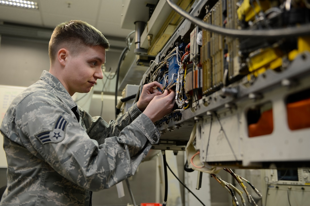 U.S. Air Force Senior Airman Christopher Peoples, 52nd Component Maintenance Squadron avionics sensors and electronic warfare systems technician from  Mount Pocono, Pa., performs maintenance on an AN/ALQ-131 electronic counter measure pod, March 12, 2014, at Spangdahlem Air Base, Germany. The ECM pod contains transmitters that allows a pilot to engage and disrupt the flight path of any incoming enemy missile. (U.S. Air Force photo by Staff Sgt. Christopher Ruano/Released)