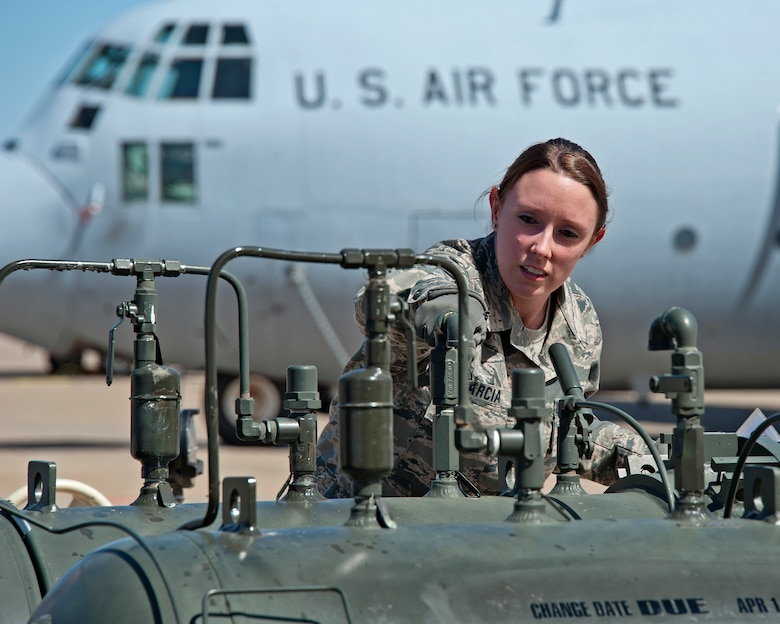 Staff Sgt. Shelese Garcia inspects an R-19 filter separator during the Fuels Operational Readiness Capability Equipment course March 13, 2014, at Sheppard Air Force Base, Texas. Garcia is with the 364th Training Squadron. An R-19 filter separator filters fine sediment out of fuel. (U.S. Air Force photo/Frank Carter)