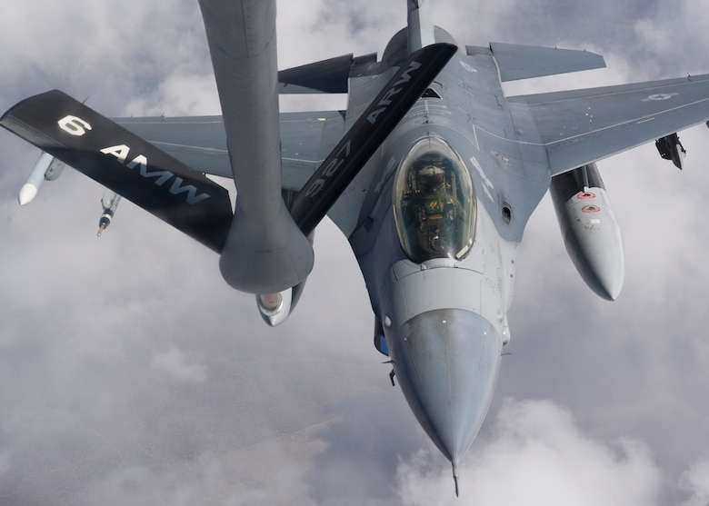 An F-16 Fighting Falcon approaches a KC-135 Stratotanker for refueling during Red Flag 14-2 March 13, 2014, over the Nevada Test and Training Range. During Red Flag, mid-air refueling allowed aircraft to save time and quickly get back into the fight, without having to return to the ground to refuel. The KC-135 is assigned to the 350th Air Refueling Squadron at McConnell Air Force Base, Kan. (U.S. Air Force photo/Airman 1st Class Timothy Young)