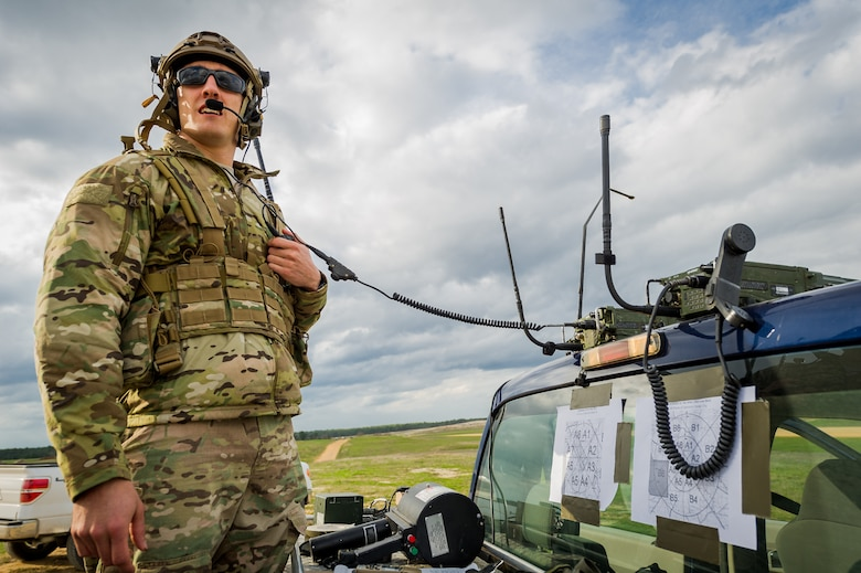 Senior Airmen Brian Colt Gass monitors the air space and weather conditions around the Geronimo landing zone March 14, 2014, at the Joint Readiness Training Center, Fort Polk, La. Service members participating in JRTC 14-05  are educated in combat patient care and aeromedical evacuation in a simulated combat environment. Gass is a combat controller with the 22nd Special Tactics Squadron at McChord Air Force Base, Wash. (U.S. Air Force photo/Master Sgt. John R. Nimmo Sr.)