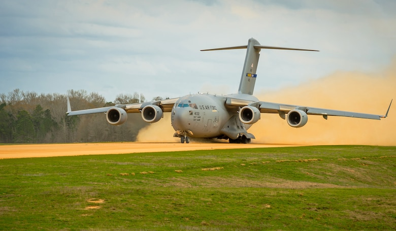 A C-17 Globemaster III takes off March 14, 2014, from the Geronimo landing zone at Joint Readiness Training Center, Fort Polk, La. Service members participating in JRTC 14-05 are educated in combat patient care and aeromedical evacuation in a simulated combat environment. (U.S. Air Force photo/Master Sgt. John R. Nimmo Sr.)