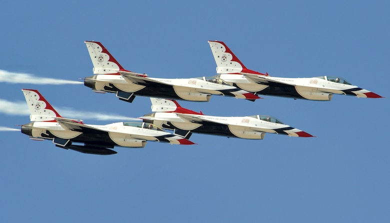 Four U.S. Air Force Thunderbird F-16 Fighting Falcons zoom by the visitors of the Lightning in the Desert Air Show March 16, 2014, on Luke Air Force Base, Ariz. The event was open to the general public to view vintage aircraft and the F-35A Lightning II. (U.S. Air Force photo by Senior Airman Marcy Copeland)
