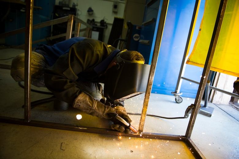 Airman 1st Class Curtis Doherty welds a section of a metal rack March 18, 2014, at Yokota Air Base, Japan. The rack will be used to store and maintain unused metal, which will increase safety and productivity. Doherty is a 374th Maintenance Squadron aircraft metals technology specialist. (U.S. Air Force photo/Staff Sgt. Chad C. Strohmeyer)