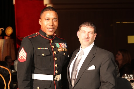 NEW YORK - Sgt. Rasheem Thomas poses for a photo with Joe Kinkade, the man he rescued after the Harlem gas leak explosion March 12, at the Marine Corps - Law Enforcement Foundation Annual Gala at the Waldorf Astoria on March 20. This was the first time Thomas has seen Kinkade since the incident.  (U.S. Marine Corps photo by Cpl. Kristin E. Moreno).