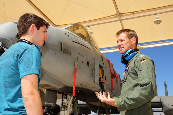 German Maj. Andreas Jeschek, 354th Fighter Squadron assistant director of operations, talks to a German Exchange student in their native tongue about the A-10 Thunderbolt at Davis-Monthan Air Force Base, Ariz., March 19, 2014. Maj. Jeschek is a North Atlantic Treaty Organization officer that was given the opportunity to foster a bilateral relationship through the Exchange Officer Program. (U.S. Air Force photo by Senior Airman Camilla Elizeu/Released)
