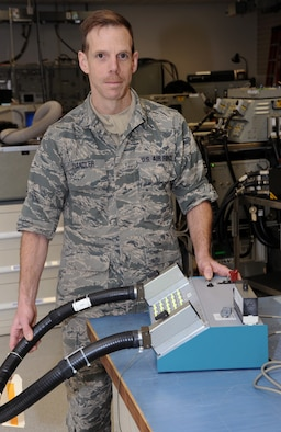 "Oregon Air National Guard Master Sgt. Michael Chandler, 142nd Fighter Wing Aircraft Maintenance avionics back shop technician, displays the AW Cable Tester he designed that recently was submitted to the U.S. Air Force, ""Every Dollar Counts."" campaign and was awarded $5,000.00., Portland Air National Guard Base, Ore., Mar. 21, 2014. (U.S. Air National Guard photo by Tech. Sgt. John Hughel, 142nd Figher Wing Public Affairs/Released)"