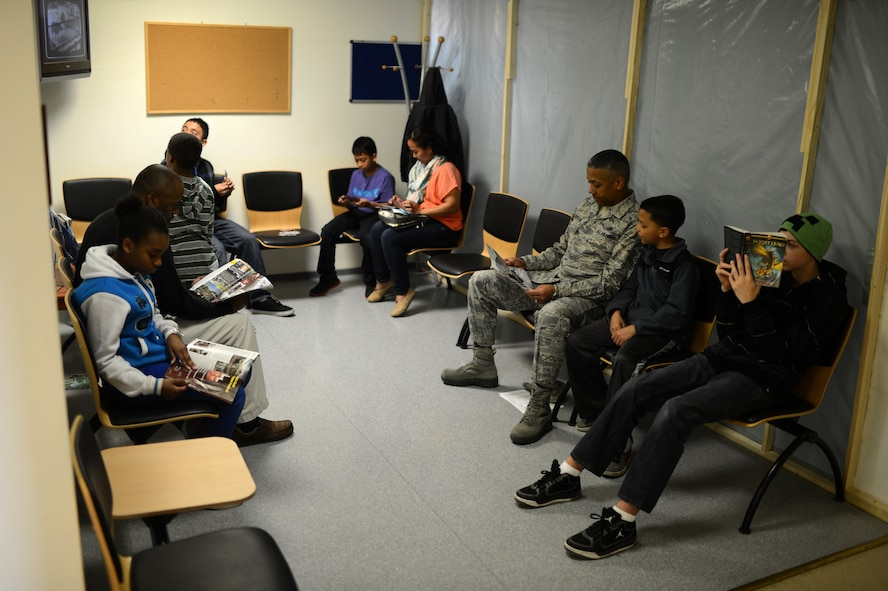 Members of the Spangdahlem community wait to be seen at a walk-in clinic for children event at Spangdahlem Air Base, Germany, March 21, 2014. The dental clinic expects to examine between 150 and 200 children throughout the day. (U.S. Air Force photo by Senior Airman Gustavo Castillo/Released)
