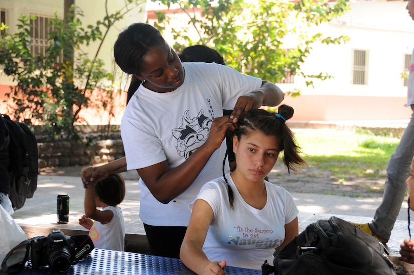 Members of Joint Task Force-Bravo's Medical Element provided some bliss for local children during an orphanage visit in Comayagua, Honduras March 22, 2014.  More than 25 members made the trip to the Hogar de Ninos, Nazareth girls orphanage where they spent a Saturday afternoon visiting with more than 50 children.  They braided the girl's hair, painted their fingernails, played soccer, read books and drew pictures with the kids.  (Photo by U. S. Air National Guard Capt. Steven Stubbs)
