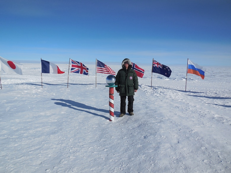 Cadet 1st Class Glen Hanson stands at the South Pole in December. The meteorology major spent a week observing climate, satellite, biological and astronomical research at McMurdo Station, Antarctica. (Courtesy photo)