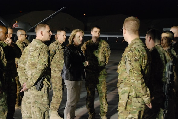Secretary of the Air Force Deborah Lee James talks with Airmen from the 451st Air Expeditionary Group during a stop at a static display on the flightline March 20, 2014, at Kandahar Airfield, Afghanistan. James received a short briefing about each aircraft and held a question and answer session after the briefings. (U.S. Air Force photo/Capt. Brian Wagner)