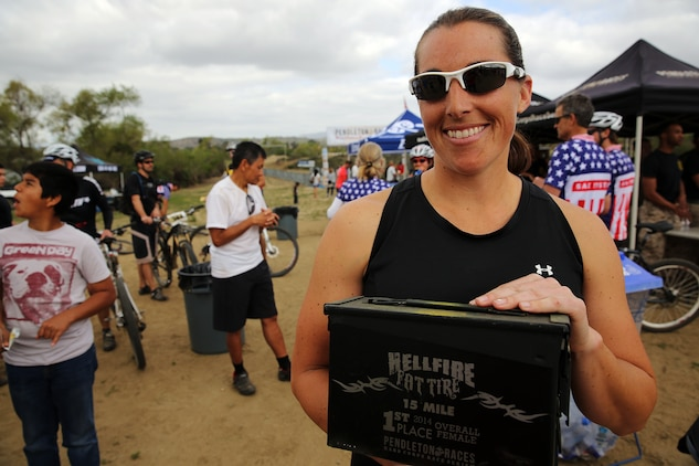 Melissa S. Martinez is women's 1st place winner of the Hell Fire Fat Tire race at Lake O'Neill on March 22, 2014. 