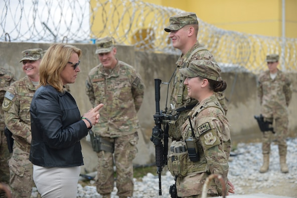 Deborah Lee James, Secretary of the Air Force, talks to Airman 1st Class Nathaniel Ripp and Airman 1st Class Kaitlyn Ramstead after receiving a post briefing from the Security Forces defenders at Bagram Airfield, Afghanistan, March 22, 2014. Ripp and Ramstead were providing security for a venue that James was speaking at during her first official visit to Afghanistan.(U.S. Air Force photo by Senior Master Sgt. Gary J. Rihn)
