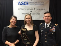 """Rachel Coyner, a San Francisco District project engineer, was presented the """"2013 Outstanding Younger Civil Engineer in the State of California"""" award during the 2013 American Society of Engineers (ASCE) region 9 awards ceremony March 14.   The ASCE Region 9 Individual Awards were presented at the 2014 California Infrastructure Symposium Awards Dinner to recognize individuals for outstanding achievements or leadership in civil engineering, or who through their work, support and advance the profession. Rachel Coyner currently serves as the ASCE San Francisco Younger Member Forum President and has been active in the ASCE organization since 2008 when she joined as a University of Nevada, Reno student member.   Rachel (Center) was joined by Lyn Gillespie, district ETS chief and Maj. Adam Czekanski, district deputy commander at the awards ceremony."""