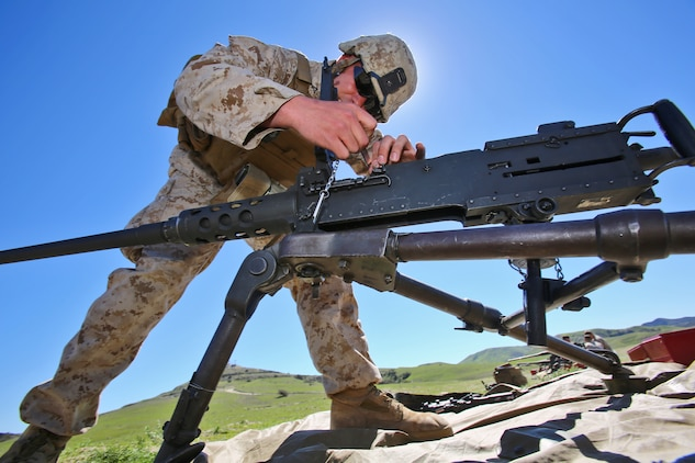 A Marine with Alpha Company, 7th Engineer Support Battalion, 1st Marine Logistics Group, assembles an M240B machine gun during a super squad competition aboard Camp Pendleton, Calif., March 10, 2014. Eight squads, of approximately 80 Marines and sailors, from Alpha Company participated in the weeklong competition that focused on infantry rifle squad skills, tested small-unit leadership and their combat-readiness. (U.S. Marine Corps photo by Cpl. Timothy Childers / Released)