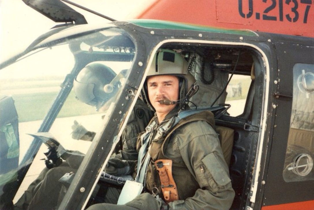 Chief Warrant Office 1 Steven Lott sits in an OH-58 scout helicopter before takeoff. Lott went to flight school from 1992 to 1993. In 1995, Lott transitioned to fixed wing aircraft. (Courtesy photo)