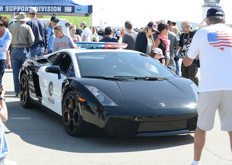 The Los Angeles Police Department displayed a promotional L.A.P.D. Ferrari patrol car. Several agencies and sponsors were on hand with booths and informational tents. (U.S. Air Force photo by Kenji Thuloweit)