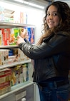 Yolanda Bottorf adds frozen dinners to one of the freezers in the Fisher House for Families of the Fallen, Dover Air Force Base, Del., March 24, 2014. Bottorf is the Families of the Fallen support manager for the USO. In her position with the USO, in addition to providing food for the Fisher House, she coordinates with USO staff to offer assistance to families traveling to Dover for a dignified transfer as well as to funerals and memorials. (U.S. Air Force photo/Roland Balik)