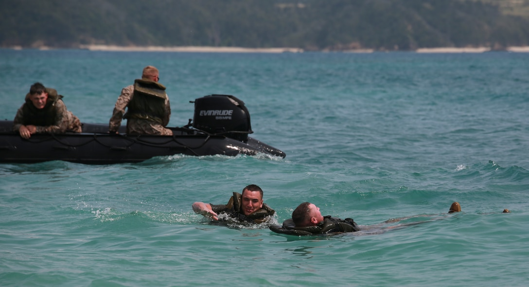 Marines execute man-overboard drills, March 19, during water-mobility training in the ocean off the Camp Schwab Beach. In each Combat Rubber Raiding Craft, a Marine was designated a safety swimmer to rescue simulated victims. The Marines are combat engineers with Company A, 9th Engineer Support Battalion, 3rd Marine Logistics Group, III Marine Expeditionary Force.