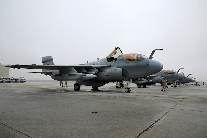 Pilots and crew with Marine Tactical Electronic Warfare Squadron 4 prepare their EA-6B Prowlers for a mission at Marine Corps Air Station Cherry Point, N.C. March 19, 2014. During the mission, the pilots conducted a division lead qualification for training pilots en route to MCAS Yuma, Ariz. VMAQ-4's mission is to support the Marine Air Ground Task Force by conducting airborne electronic warfare.