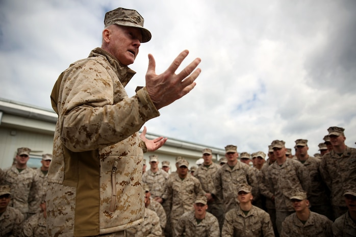 Lieutenant Gen. Richard Tryon, commander of U.S. Marines Forces Command and U.S. Marine Corps Forces, Europe, talks with Marines of 3rd Battalion, 8th Marine Regiment, 2nd Marine Division assigned to Black Sea Rotational Force 14, aboard Mihail Kogalniceanu Air Base, Romania, March 17, 2014. Tryon visited the base to speak to the Marines on BSRF-14 and to tour the installation. Black Sea Rotational Force 14 is a contingent of Marines and sailors tasked with maintaining positive relations with partner nations, regional stability and increasing interoperability while providing the capability for rapid crisis response, as directed by U.S. European Command, in the Black Sea, Balkan and Caucasus regions of Eastern Europe. (Official Marine Corps photo by Lance Cpl. Scott W. Whiting, BSRF PAO/ Released)