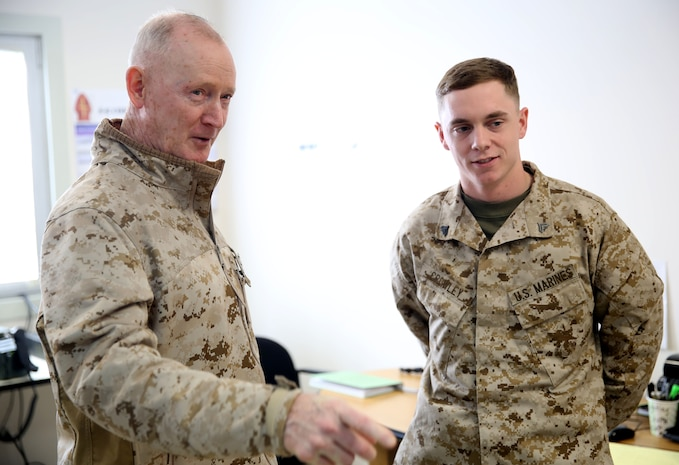 Lieutenant Gen. Richard Tryon, commander of U.S. Marines Forces Command and U.S. Marine Corps Forces, Europe, speaks with Cpl. Christopher Crowley, a Marine with 3rd Battalion, 8th Marine Regiment, 2nd Marine Division assigned to Black Sea Rotational Force 14, aboard Mihail Kogalniceanu Air Base, Romania, March 17, 2014. Tryon visited the installation to meet the Marines and tour the base, talking with Marines as he visited the different sections aboard the air base. Black Sea Rotational Force 14 is a contingent of Marines and sailors tasked with maintaining positive relations with partner nations, regional stability and increasing interoperability while providing the capability for rapid crisis response, as directed by U.S. European Command, in the Black Sea, Balkan and Caucasus regions of Eastern Europe. (Official Marine Corps photo by Lance Cpl. Scott W. Whiting, BSRF PAO/ Released)