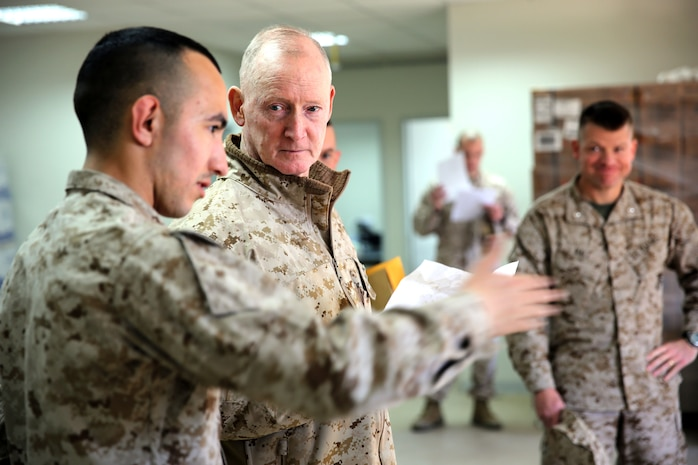 Lieutenant Gen. Richard Tryon, commander of U.S. Marines Forces Command and U.S. Marine Corps Forces, Europe, speaks with Cpl. Jonathan Orozco, a food service specialist with 3rd Battalion, 8th Marine Regiment, 2nd Marine Division assigned to Black Sea Rotational Force 14, aboard Mihail Kogalniceanu Air Base, Romania, March 17, 2014. Tryon visited the installation to meet the Marines and tour the base, talking with Marines as he visited the different sections aboard the air base. Black Sea Rotational Force 14 is a contingent of Marines and sailors tasked with maintaining positive relations with partner nations, regional stability and increasing interoperability while providing the capability for rapid crisis response, as directed by U.S. European Command, in the Black Sea, Balkan and Caucasus regions of Eastern Europe. (Official Marine Corps photo by Lance Cpl. Scott W. Whiting, BSRF PAO/ Released)