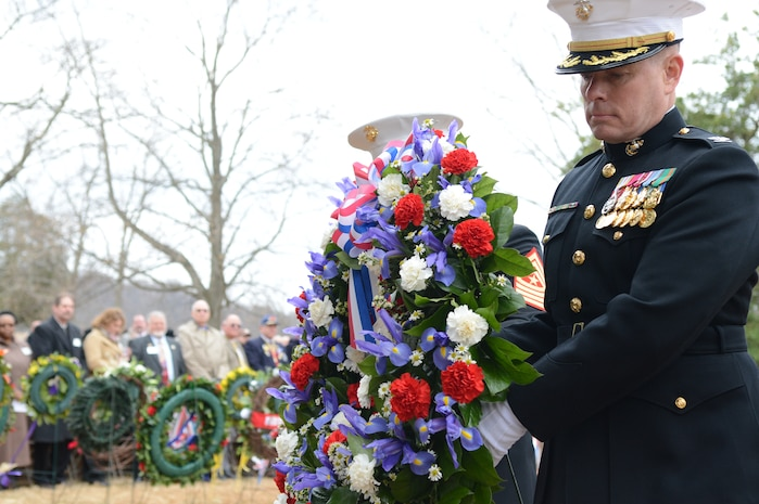 Col. David Maxwell, Marine Corps Base Quantico base commander, carries a presidential wreath to the resting place of James Madison, the fourth president of the United States of America. Maxwell was selected by President Barack Obama to present the wreath at Madison's obelisk as part of a tradition of honoring all former commanders-in-chief.