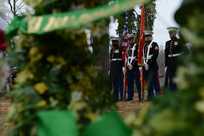 The Marine Corps Base Quantico Color Guard stands at ease during the proceedings of the James Madison wreath laying ceremony on March 16, 2014. Each year, wreaths are laid at the final resting places of former United States Presidents across the nation.