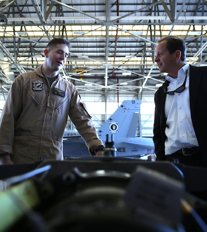 Captain Jack Holloway, a pilot with Marine All-Weather Fighter Attack Squadron 533, explains aviation equipment and their uses during a tour of VMFA(AW)-533 by members of the Medal of Honor Society, March 14.