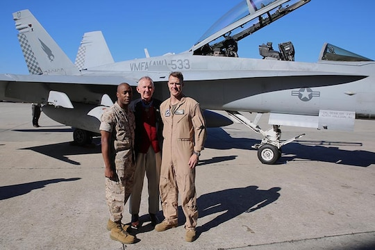 Retired Maj. Gen. James E. Livingston (center), a Medal of Honor recipient, takes a picture with Sgt. Maj. Derrick N. Mays (left), the squadron sergeant major of Marine All-Weather Fighter Attack Squadron 533, and Lt. Col. Kevin O'Rourke (right), the commanding officer of VMFA(AW)-533, during a tour of VMFA(AW)-533, March 14.