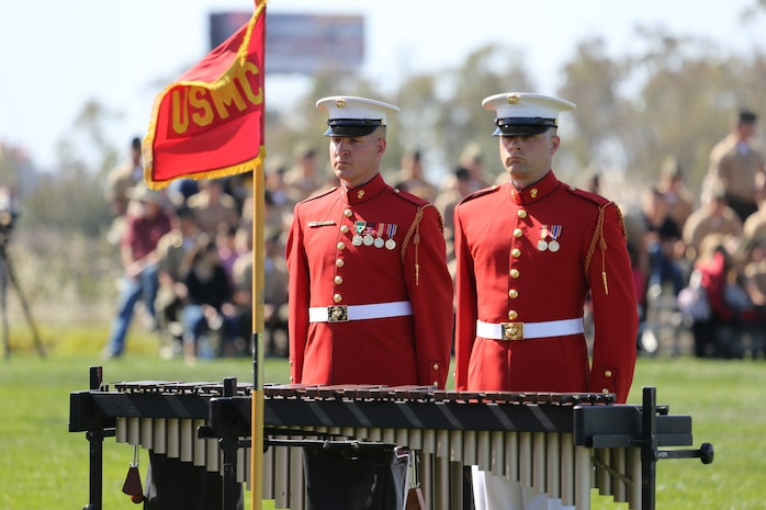 Marines with the Battle Color Detachment stand at attention after a song during a performance aboard Marine Corps Air Station Miramar, Calif., March 14.