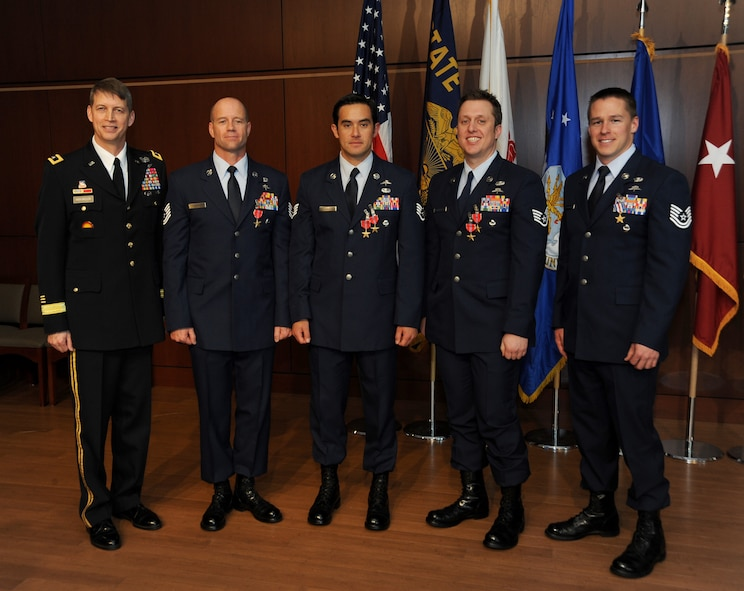 Combat controllers with the Oregon Air National Guard's 125th Special Tactics Squadron stand in for a group photo with Maj. Gen. Daniel R. Hokanson, (left), Adjutant General, Oregon, following an award ceremony, March 24, at the 41st Infantry Division Armed Forces Reserve Center at Camp Withycombe, in Clackamas, Ore. From left: Maj. Gen. Daniel Hokanson; Tech. Sgt. George Thompson received the Bronze Star; Staff Sgt. Christopher Jones received the Bronze Star with Valor and first Oak Leaf Cluster; Staff Sgt. Matthew Matlock received the Bronze Star Medal with Valor and second Oak Leaf Cluster; and Tech. Sgt. Doug Matthews received the rarely awarded Silver Star; and. (U.S. Air National Guard photo by Tech. Sgt. John Hughel, 142nd Fighter Wing Public Affairs/Released)
