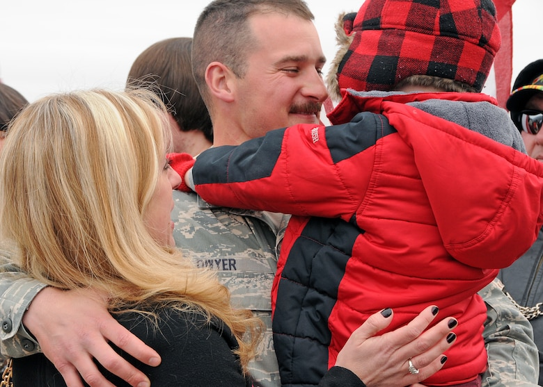 Familiy and friends rush to greet their loved ones upon their return. The Airmen are members of the 143d Airlift Wing returning from a deployment to Kuwait in support of Operation Enduring Freedom. National Guard Photo by Master Sgt Janeen Miller (RELEASED)