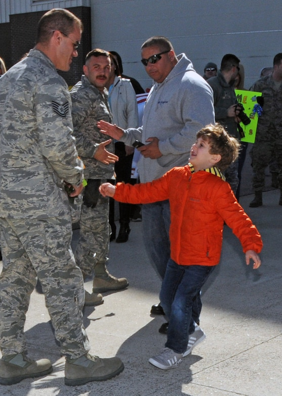 Familiy and friends rush to greet their loved ones upon their return. The Airmen are members of the 143d Airlift Wing returning from a deployment to Kuwait in support of Operation Enduring Freedom.. National Guard Photo by Master Sgt Janeen Miller (RELEASED)