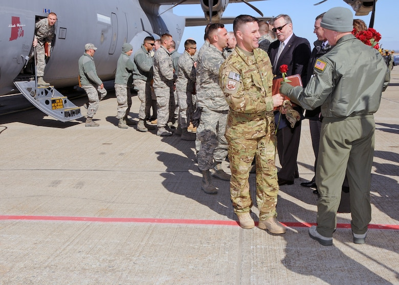 Members of the 143d Airlift Wing, returning from a deployment to Kuwait in support of Operation Enduring Freedom, are greeted by Wing and State Leadership. National Guard Photo by Master Sgt Janeen Miller (RELEASED)