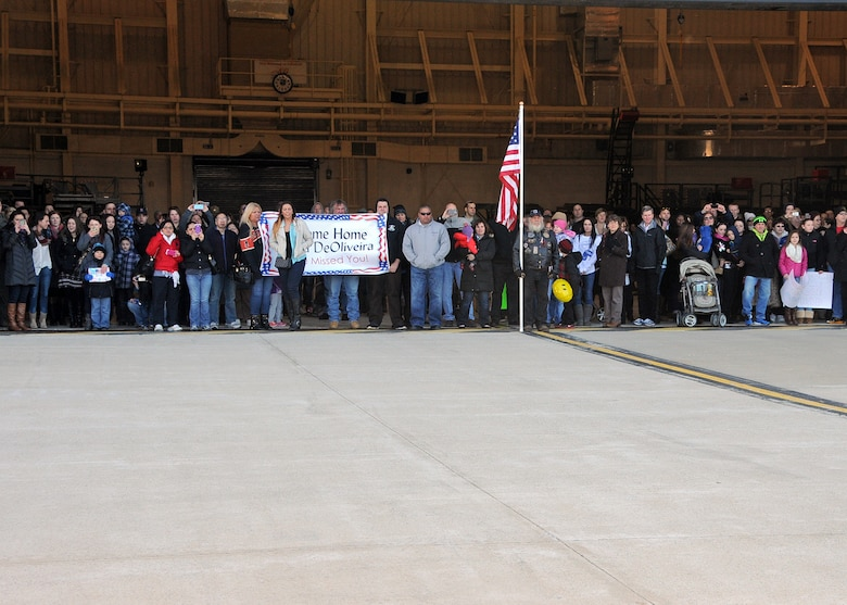 Excited family and friends await the arrival of the C-130J Super Hercules carrying members of the 143d Airlift Wing returning from a deployment to Kuwait in support of Operation Enduring Freedom. National Guard Photo by Master Sgt Janeen Miller (RELEASED)