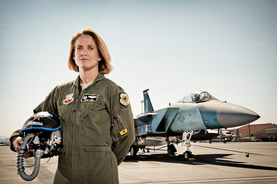 "Lt. Col. Carey Jones, 561th Joint Tactics Squadron commander and F-15C Eagle pilot, poses on the Nellis Air Force Base Nev. flightline March 21, 2014.  Women's History Month had its origins as a national celebration in 1981 when Congress passed Public Law 97-28 which authorized and requested the President to proclaim the week beginning March 7, 1982 as ""Women's History Week.""   In 1987 after being petitioned by the National Women's History Project, Congress passed into public law designating the month of March as ""Women's History Month.""  (U.S. Air Force photo by Lorenz Crespo)"