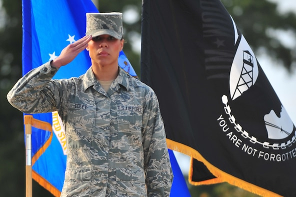 Senior Airman Amber Coley, 4th Medical Operations Squadron physical therapist, salutes during the 4th Fighter Wing Prisoner of War/Missing in Action (POW/MIA) ceremony, Sept. 20, 2013, at Seymour Johnson Air Force Base, N.C.  Coley performed in the colors flight for three years during her tour with the U.S Air Force Honor Guard.  (U.S. Air Force photo/Senior Airman Aubrey White)