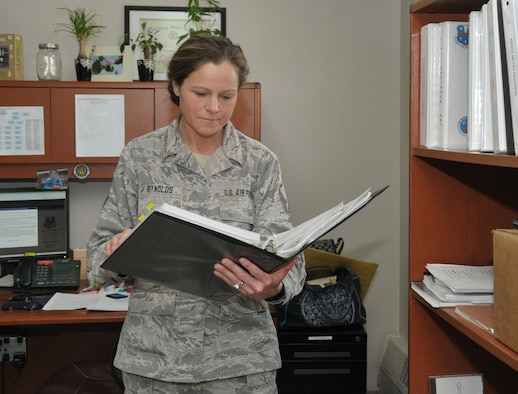 STRATTON AIR NATIONAL GUARD BASE, N.Y. -- Master Sgt. Faye Reynolds, 109th Civil Engineer Squadron supply manager, goes over a continuity binder in her office. She has been in the Air Force for more than 20 years and has held multiple jobs throughout the years. (Air National Guard photo by Master Sgt. William Gizara/Released)